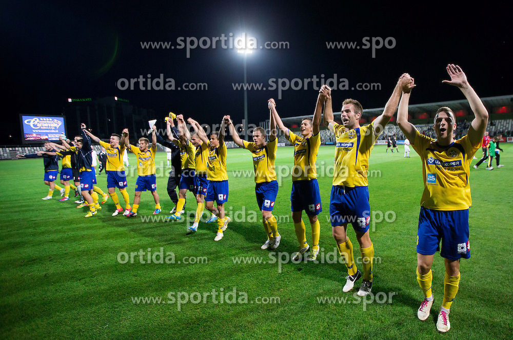 Players of Koper celebrate after winning the football match between FC Luka Koper and NK Celje 9th Round of Slovenian First League PrvaLiga NZS 2012/13 on September 16, 2012 in Stadium Bonifika, Koper, Slovenia. Koper defeated Celje 1-0. (Photo By Vid Ponikvar / Sportida)