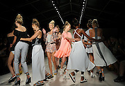 Models dance at the finale of the Nanette Lepore Spring 2015 show during Fashion Week in New York, Sunday, Sept. 7, 2014.  (AP Photo/Diane Bondareff)