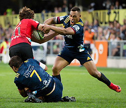 Highlanders' Tevita Li, right, and Dillon Hunt tackle Crusaders' George Bridge in the Super Rugby match, Forsyth Barr Stadium, Dunedin, New Zealand, Saturday, March 17, 2018. Credit:SNPA / Adam Binns ** NO ARCHIVING**