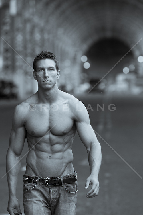 shirtless man walking in New York City