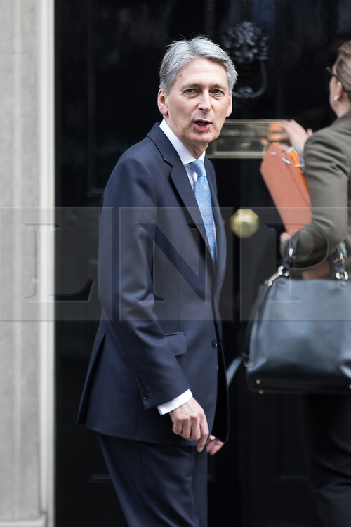 © Licensed to London News Pictures . 29/03/2017 . London , UK . PHILIP HAMMOND arrives . Ministers arriving and leaving for a Cabinet meeting and Prime Minster's Questions , at 10 Downing Street , Westminster . Today (29th March 2017) the British Government will trigger Article 50 of the Lisbon Treaty and commence Britain's withdrawal from the European Union . Photo credit : Joel Goodman/LNP