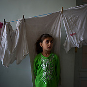 August 11, 2012 - Azaz, Aleppo, Syria: A syrian girl stands by in the room of an improvised refugee center in Azaz, where 32 families who fled the combat areas are temporarily living. (Paulo Nunes dos Santos)