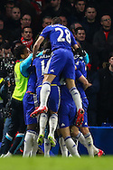 Branislav Ivanovic of Chelsea celebrates scoring the opening goal against Liverpool with team mates during the Capital One Cup Semi Final 2nd Leg match between Chelsea and Liverpool at Stamford Bridge, London, England on 27 January 2015. Photo by David Horn.