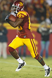 September 11, 2010; Los Angeles, CA, USA;  Southern California Trojans wide receiver Ronald Johnson (83) rushes up field after a pass reception against the Virginia Cavaliers during the second quarter at the Los Angeles Memorial Coliseum. USC defeated Virginia 17-14.