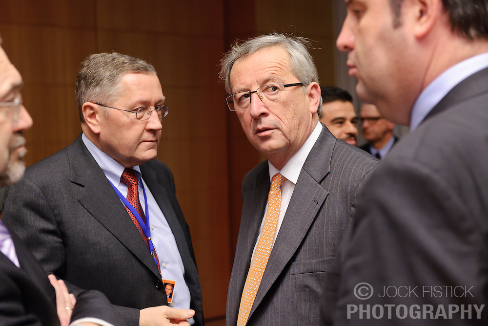 Jean-Claude Juncker, Luxembourg's prime minister, and president of the Eurogroup, center, speaks with Klaus Regling, chief executive officer of the European Financial Stability Fund (EFSF), left, and Josef Proell, Austria's finance minister, right, during the Eurogroup meeting in Brussels, Monday Dec. 6, 2010.  (Photo © Jock Fistick)