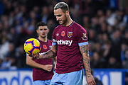 Marko Arnautovic of West Ham United (7) in action with Aaron Cresswell of West Ham United (3) in the background ready to take a thrown in during the Premier League match between Huddersfield Town and West Ham United at the John Smiths Stadium, Huddersfield, England on 10 November 2018.