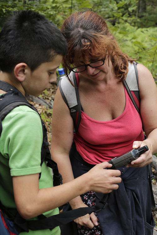 Catherine Bohne with local children on a camera trap excursion, Valbona, Albania.