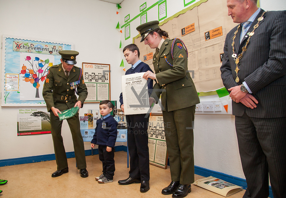 23/10/2015       <br /> Members of the Defence Forces were in Abbeyfeale today to present a handmade Tricolour and a copy of the Proclamation of the Irish Republic to students of the town's two primary schools.<br /> <br /> St Marys Boys National School and Scoil Mh&aacute;thair D&eacute; are among 3,000 schools nationally and 152 Limerick primary schools to receive the presentation as part of initiatives to mark the centenary of the 1916 Rising.&nbsp;<br /> <br /> Councillor Liam Galvin, Mayor of the City and County of Limerick joined pupils and teachers for today's presentation ceremony, which saw representatives of the Defences Forces raise the flag and read the Proclamation. <br /> <br /> Attending the ceremony at St. Marys Boys National School were, Sergeant James Reddan, Dillon O'Brien, 4, Mark Roche, 12 and Private Ciara Quinn. Picture: Alan Place.