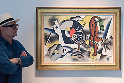 "© Licensed to London News Pictures. 28/06/2018. LONDON, UK. A visitor walks by ""La femme aux clés"", 1930 by Fernand Léger.  Members of the public visit Masterpiece London, the world's leading cross-collecting art fair held in the grounds of the Royal Hospital Chelsea.  The fair brings together 160 international exhibitors presenting works from antiquity to the present day and runs 28 June to 4 July 2018.  Photo credit: Stephen Chung/LNP"