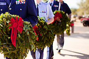 09 DECEMBER 2011 - PHOENIX, AZ:  Members of the Civil Air Patrol walk through the national cemetery in Phoenix before laying Christmas wreaths on veterans' graves. Several hundred volunteers and veterans gathered at the National Memorial Cemetery of Arizona in Phoenix Saturday to lay Christmas wreaths on headstones, a tradition started by Wreaths Across America. Wreaths Across America is a nonprofit organization founded to continue and expand the annual wreath laying ceremony at Arlington National Cemetery begun by Maine businessman, Morrill Worcester, in 1992.   PHOTO BY JACK KURTZ