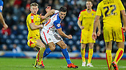 Ben Marshall (Blackburn Wanderers) turns the Rotherham player during the Sky Bet Championship match between Blackburn Rovers and Rotherham United at Ewood Park, Blackburn, England on 11 December 2015. Photo by Mark P Doherty.