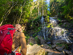 Male hiker admiring waterfall in the Black Forest, Baden-Wuerttemerg, Germany