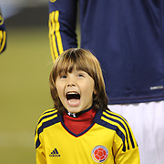 Young children who led out the Colombian team during the Colombian National Anthem during the Brazil V Colombia International friendly football match at MetLife Stadium, New Jersey. USA. 14th November 2012. Photo Tim Clayton