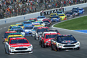 Kevin Harvick (4) leads the field to the start of during Monster Energy Cup Series O'Reilly Auto Parts 500 at Texas Motor Speedway on Sunday April 9th, 2017 in Fort Worth TX.