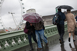 Pedestrians cover themselves with an umbrella amid rain and wind, London, UK, 14th May, 2013. Photo by: Daniel Leal-Olivas / i-Images