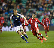 Scotland&rsquo;s Christophe Berra and Canada&rsquo;s Simeon Jackson - Scotland v Canada, friendly international at EasterRoad, Edinburgh.Photo: David Young<br /> <br />  - &copy; David Young - www.davidyoungphoto.co.uk - email: davidyoungphoto@gmail.com