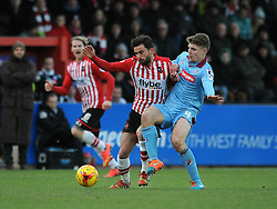 Exeter City's Arron Davies challenges for the ball with Tranmere Rovers's Max Power - Photo mandatory by-line: Dougie Allward/JMP - Mobile: 07966 386802 - 31/01/2015 - SPORT - Football - Exeter - St James Park - Exeter City v Tranmere Rovers - Sky Bet League Two