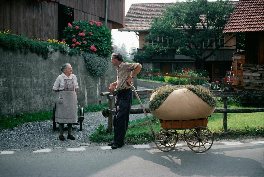 Couple talking, Interlaken, Switzerland.