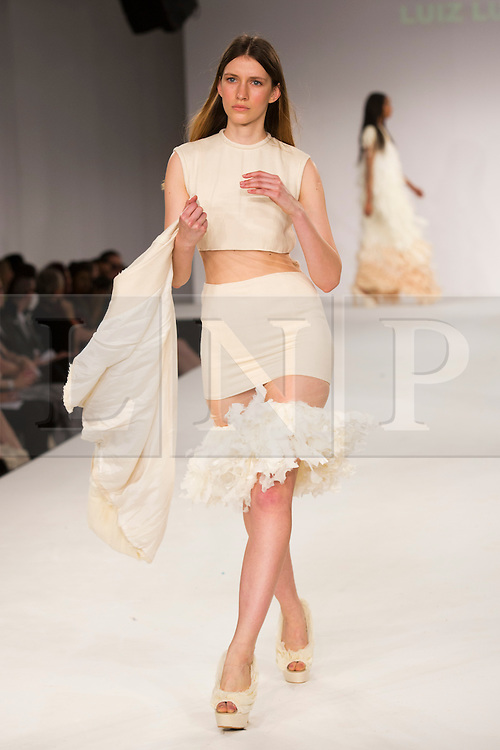 © Licensed to London News Pictures. 31/05/2014. London, England. Collection by Luiz Lula Filho from UEL, University of East London. Graduate Fashion Week 2014, Runway Show at the Old Truman Brewery in London, United Kingdom. Photo credit: Bettina Strenske/LNP