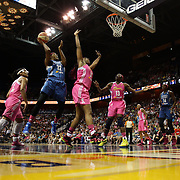 Rebekkah Brunson, (left), Minnesota Lynx, drives to the basket defended by Kelsey Bone, Connecticut Sun, during the Connecticut Sun Vs Minnesota Lynx, WNBA regular season game at Mohegan Sun Arena, Uncasville, Connecticut, USA. 27th July 2014. Photo Tim Clayton
