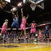Rebekkah Brunson, (left), Minnesota Lynx, drives to the basket defended by Kelsey Bone, Connecticut Sun, during the Connecticut Sun Vs Minnesota Lynx, WNBA regular season game at Mohegan Sun Arena, Uncasville, Connecticut, USA. 27th July 2014. Photo Tim Clayton