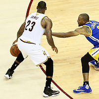 10 June 2016: Golden State Warriors forward Andre Iguodala (9) defends on Cleveland Cavaliers forward LeBron James (23) during the Golden State Warriors 108-97 victory over the Cleveland Cavaliers, during Game Four of the 2016 NBA Finals at the Quicken Loans Arena, Cleveland, Ohio, USA.
