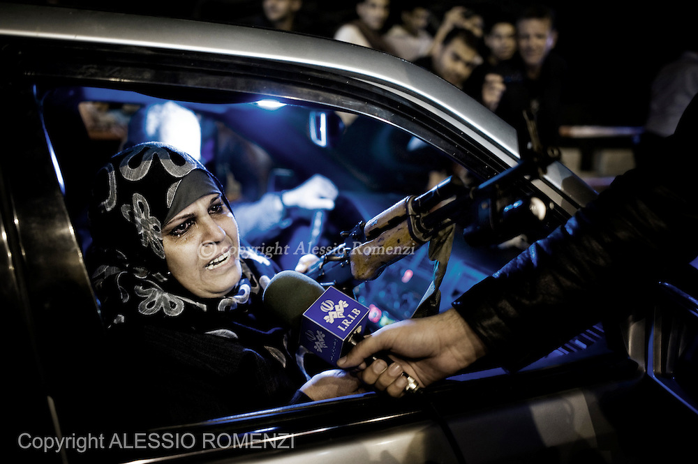 Gaza City: A palestinian woman release an interview holdin an AK-47 during celebrations for the cease-fire agreement between Israel and Gaza in Gaza City, November 21, 2012. ALESSIO ROMENZI