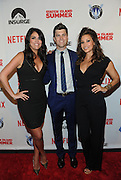 Saturday Night Live head writer and screenwriter Colin Jost, center, celebrates the premiere of his movie Staten Island Summer with SNL's Cecily Strong, left, and actress Gina Gershon at Sunshine Cinema, Tuesday, July 21, 2015, in New York.  The new comedy debuts on Netflix on July 30, 2015 and is available for Digital download. (Photo by Diane Bondareff/Invision for Paramount Pictures/AP Images)