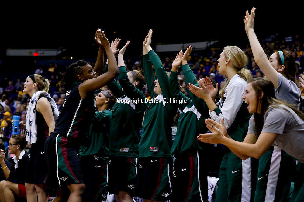 Mar 24, 2013; Baton Rouge, LA, USA; Green Bay Phoenix forward Breannah Ranger (3) celebrates with teammates on the bench in the first half of a game against the LSU Tigers during the first round of the 2013 NCAA womens basketball tournament at the Pete Maravich Assembly Center.  Mandatory Credit: Derick E. Hingle-USA TODAY Sports