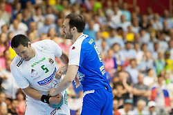 Istvan Timuzsin Schuch #5 of Hungary and Jure Natek #9 of Slovenia during handball match between National teams of Slovenia and Hungary in play off of 2015 Men's World Championship Qualifications on June 15, 2014 in Rdeca dvorana, Velenje, Slovenia. Photo by Urban Urbanc / Sportida