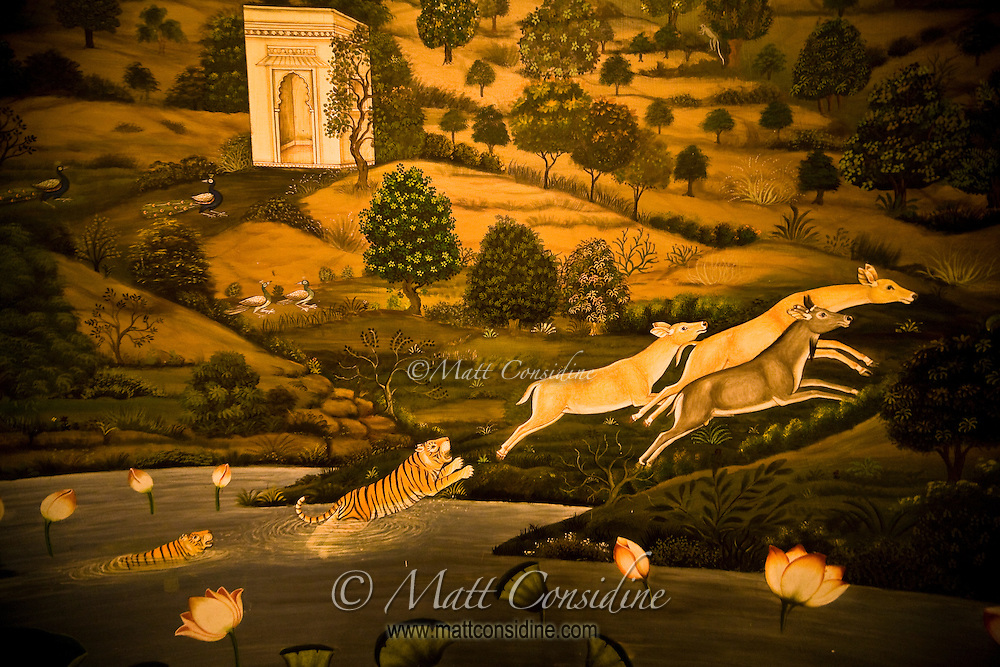 One of a series of fabulous frescoes, this one depicts tigers chasing deer in a distinctively Indian countryside. Located in the Oberoi Udaivilas in Udaipur.<br /> (Photo by Matt Considine - Images of Asia Collection)
