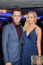 TYGER DREW-HONEY and AMY SEATON at the Chain of Hope Ball held in aid of the charity Chain of Hope, founded by Professor Sir Magdi Yacoub which organises volunteer teams worldwide to operate on children suffering from life-threatening heart diseases, held at the Grosvenor House Hotel, Park Lane, London on 20th November 2015.