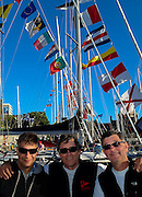 Charles Rice, Dave Moran and Scott Campbell visiting other boats in Victoria Harbour the day before the start.  2014 Swiftsure International Yacht Race, Victoria, British Columbia, Canada.  Olympus Tough TG-1.