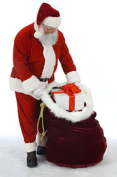 Full Santa removing a present from his gift sack