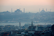 Istanbul. Golden Horn (Halic?) with Hagia Sophia (l.) and Blue Mosque (Sultan Ahmet Camii), seen from 360° Istanbul bar and restaurant in Istiklal Street pedestrian zone, at sunset.