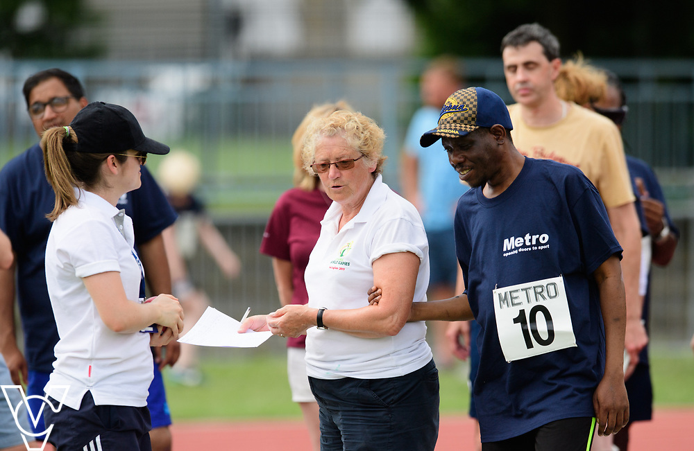 Metro Blind Sport's 2017 Athletics Open held at Mile End Stadium.  Shot put.  William Safo with official<br /> <br /> Picture: Chris Vaughan Photography for Metro Blind Sport<br /> Date: June 17, 2017