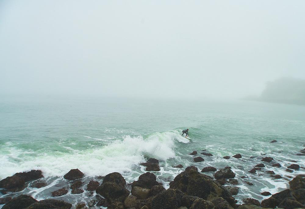 Surfer surfing the San Francisco Bay Golden Gate Bridge
