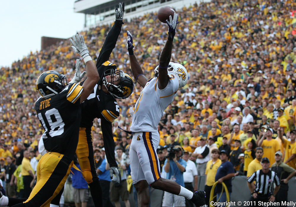 September 3, 2011: Tennessee Tech Golden Eagles wide receiver Tim Benford (3) can't pull in a pass as Iowa Hawkeyes cornerback Micah Hyde (18) and Iowa Hawkeyes defensive back Greg Castillo (2) defend during the second half of the game between the Tennessee Tech Golden Eagles and the Iowa Hawkeyes at Kinnick Stadium in Iowa City, Iowa on Saturday, September 3, 2011. Iowa defeated Tennessee Tech 34-7 in a game stopped at one point due to lightning and rain.