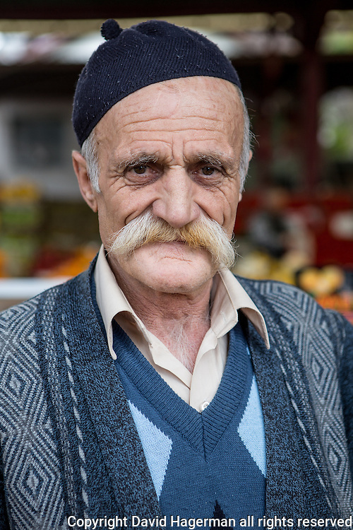 A vendor at Inebolu's Saturday market shows off his luxuriant moustache.
