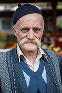 A vendor at Inebolu's Saturday market shows off his luxuriant moustache.
