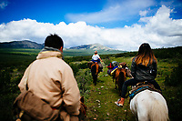 Guides and travelers ride horses into the East Taiga forests of northern Mongolia to visit the remote, nomadic reindeer herders that live near the Siberian borders of the country.
