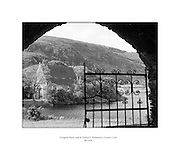 Views - Gougane Barra and St Finbarr's Monastery, Co. Cork .06/1954..Gougane Barra is a settlement, west of Macroom in County Cork, Ireland..The name Gougane Barra comes from Saint Finbarr, who is said to have built a monastery on an island in the lake nearby during the 6th century. The present ruins date from around 1700 when a priest called Denis O'Mahony retreated to the island. During the times of the Penal Laws, Gougane Barra's remoteness meant that it became a popular place for the celebration of the Roman Catholic Mass..Afforestation of the area around the settlement began in 1938 and Gougane Barra is now home to a 1.42 square kilometre forest park which is home to a number of mammal and bird species.