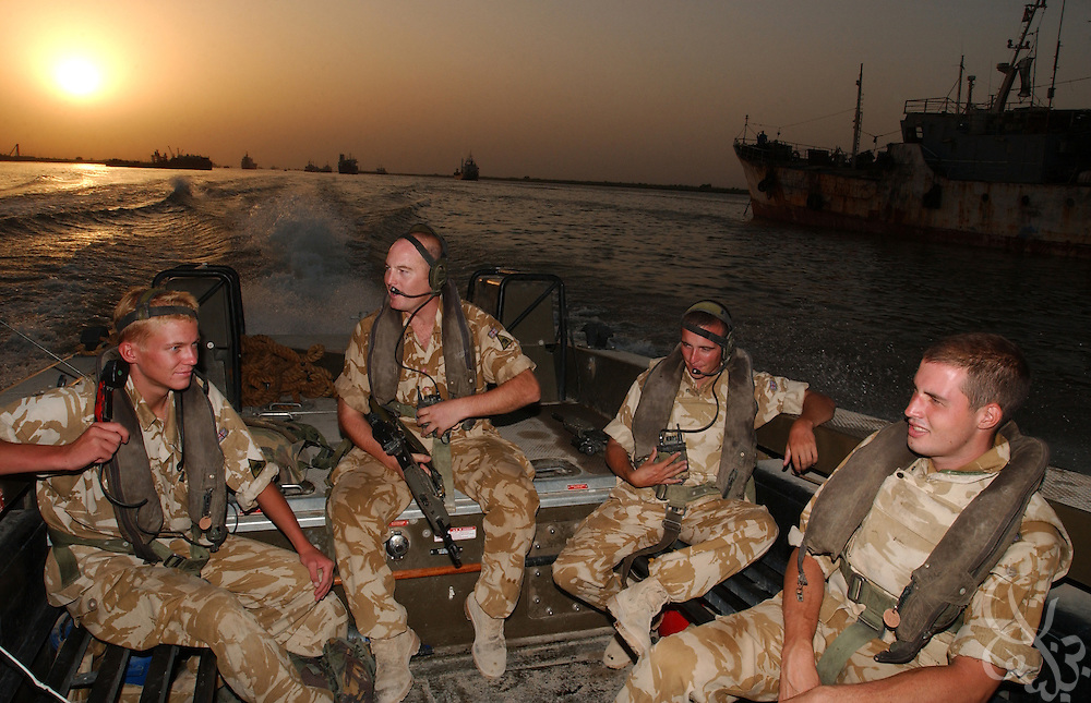 (From L to R) Royal Artillery 38 Battery 40 Regiment Gunner Daniel Parsons from Mansfield, England, Bombadier Naylor Ewen, from Camberley, England and Gunner Alan Magowan, from Warrington, England and Lance Bombadier Mark Spender, from Ilford, England ride in a British Army patrol boat to conduct a September 6, 2003 lookout for smugglers down the Shatt al-Arab river near Basra, Iraq.