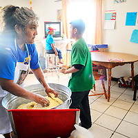060113  Adron Gardner/Independent<br /> <br /> Surrounded by grandchildren, Nadine Chapito kneads dough before baking bread  in Zuni Saturday.  &quot;Being sober, I feel like I have a second chance raising my grandchildren,&quot; Chapito said.