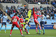 Swindon Town goalkeeper Tyrell Belford (25)  punches another corner clear during the Sky Bet League 1 match between Coventry City and Swindon Town at the Ricoh Arena, Coventry, England on 19 March 2016. Photo by Simon Davies.