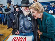 19 JANUARY 2020 - DES MOINES, IOWA: ROBERT RISIUS, from Indianola, IA, talks to US Senator ELIZABETH WARREN (D-MA) during a campaign event in Des Moines Sunday. With just two weeks to go before the Iowa Caucuses, Sen. Warren is campaigning in the Des Moines area this weekend to support her effort to be the Democratic nominee for the US presidential race in 2020. Iowa traditionally hosts the first presidential selection event of the campaign season. The Iowa caucuses are Feb. 3, 2020.          PHOTO BY JACK KURTZ