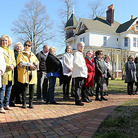 Local residents, members of the Tupelo Garden Club and city officials gathered at the John Allen Fish Hatchery for the unveiling of a bronze bust of John Allen Wednesday morning in Tupelo. The Godwin Family of Tupelo commissioned Mississippi Artist William Beckwith to create the bronze bust of John Allen in memory of Mrs. Louise Godwin.