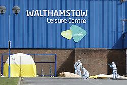 © Licensed to London News Pictures. 03/04/2018. London, UK. Police in protective overalls gather evidence outside Walthamstow Leisure Centre after a youngster was shot and another was stabbed. A few miles away on Tottenham police are investigating after a 17 year old girl was shot and killed late last night. Photo credit: Peter Macdiarmid/LNP