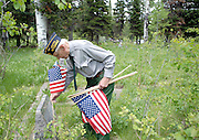 NEWS&GUIDE PHOTO / PRICE CHAMBERS.Maurice Zardis places flags on the graves of veterans buried at the Wilson Cemetery on Sunday, as he has done each memorial day weekend for about the last 15 years. The world war II veteran was drafted near the end of the war and worked in the United States assisting an engineering batalion.