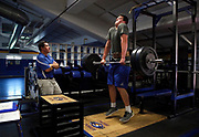 Junipero Serra High School football player Jack Dreyer (right) jump shrugs more than 240 pounds as head coach Patrick Walsh checks his form during a workout session at the school's weight room, Wednesday, March 25, 2015, in San Mateo, Calif. Dreyer, age 17, who is 6 feet 8 inches tall, weighs almost 300 pounds and has a 4.25 GPA, has signed with Stanford with a full scholarship to play outside tackle.